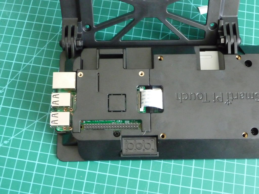 The trap door holds the Pi in place without screws allowing quick access.
